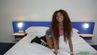 Curly ebony hottie along with very long legs at once September 2011 Reign gives man a natural environment drive
