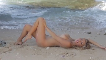 Stunning needled on blond stripping and posing with the seashore