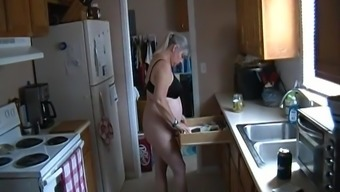 Kim Bates gets uncovered in the kitchen. Can the woman help you?