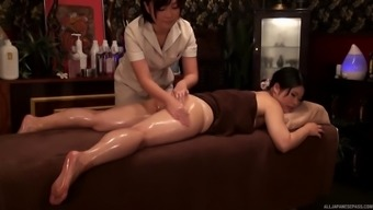 Two different stunning Japanese girls change the massage session into lesbian act