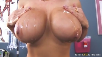 lisa ann pours a large amount of petrol through out her impressive boobs