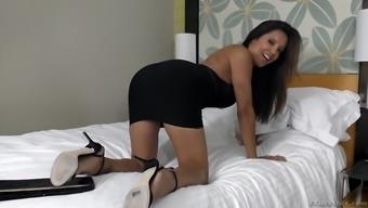 francesca le posing in a skin-tight dark colored dress