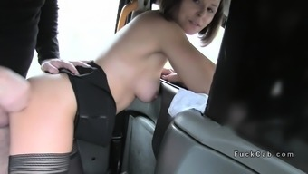 natural busty lady gives footjob in taxi cab