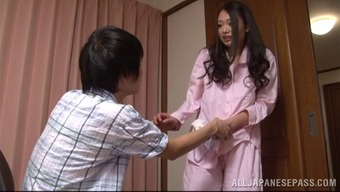 A charming Japanese people homemaker gives her mankind a handjob