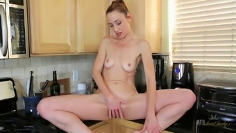Lean sexy Milf Betty Intensity masturbates in the cooking area