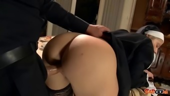 Horny nun in dark colored stockings fucked through priest