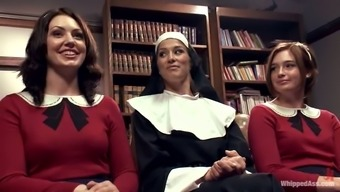 Sexy nun manipulates a couple of sexy girls at school uniform
