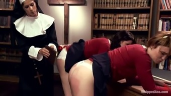 Sexy nun manipulates a couple of sexy girls at school uniform