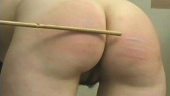 Schoolgirl lower spanked and caned