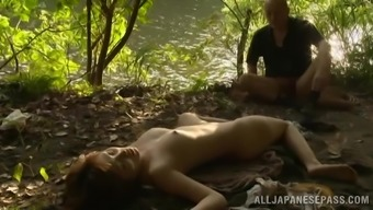 Japanese milf Mei gets her clit fucked from behind outdoor