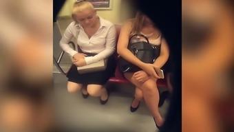 patry legs crossed togeth both legs on metro