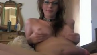 Heated newbie Shemale with Glasses jerks it hard