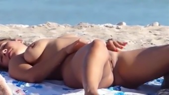 Gorgeous blonde uncovered on a nudist seashore