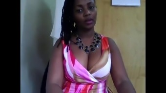 West african MILF in business office on camera