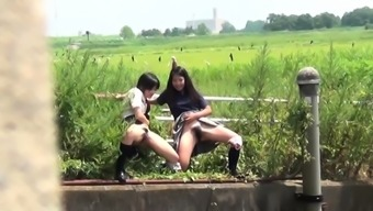 Wild oriental tramps urinating