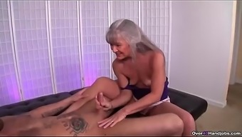 ov40-Mature slut jerking a young one