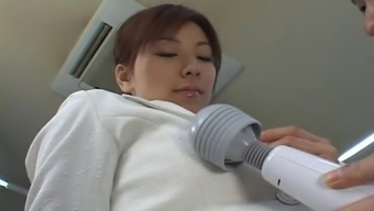 Astounding Japanese hottie gets her bald pussy satisfied with a toy