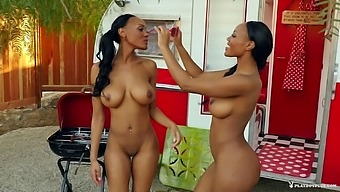Ebony twins take off their clothes and pose in the garden