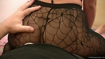 Solo chick in a miniskirt and nylon pantyhose teases the camera