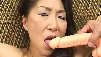 Naughty cougar Nanako Shimada gets pleased with some sex toys