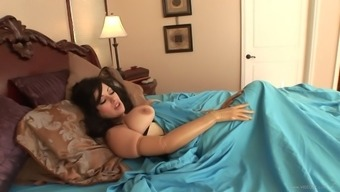 Malicious MILF with large nipples,in a leather-based tub chair loves her brushed pussy chastisize