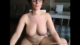 Fascinating Large Breasted Milf Flaunts With the Stormy Twat