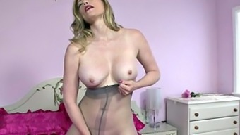 Lady Along with Pantyhose Plays With the use of Herself