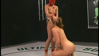 Warm chick in scarlet mask pounds Christina Shipper in a chain