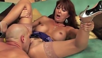 Lovely mature redhead in stockings fuck on the sofa